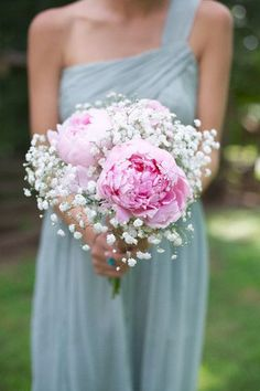 LOVING! A beautiful peony and baby's breath bridesmaid bouquet. The pink looks so great with the bridesmaid's gown don't you think?! {Live View Studios}
