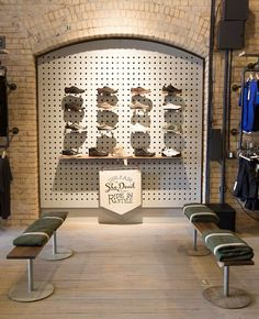 Handsome Cycle store by KNOCK, Minneapolis  store design -  love the peg board and benches with army blankets for padding