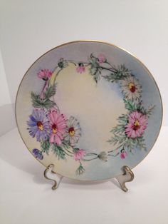 B & Co., Bernardaud and Co. ~ Limoges hand painted plate ~ Inside the gold edge is a beautiful light sky blue color which fades in and out to a light yellow ~ Pink and lilac-blue as well as white daisies border the plate ~  Circa 1900-1914