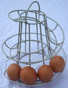 Clay coloured Helter skelter shaped egg rack