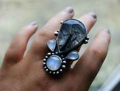 Reserved (Balance) -Darkflower ----- Tourmalated Quartz and Moonstone Sterling Silver Ring. $145.00, via Etsy.