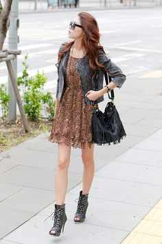 A leopard print dress with cropped black jacket, boots and bag looks stylish and works fine even on warmer days.  -Lily