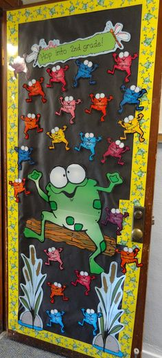 "We love how the second grade teaching team plans classroom decor together - lending a unifying theme to the whole floor. This year they chose a frog theme, inviting their kiddos to ""hop on in"" to. Classroom Door Displays, School Displays, Classroom Themes, Book Displays, Welcome Door Classroom, Door Bulletin Boards, Class Door, School Door Decorations, School Doors"