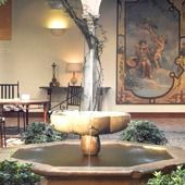 The Parador of Granada is a small four star hotel in a fifteenth century convent which is part of the famous Palace of Alhambra - holy god, for $250/night I could stay IN the Alhambra!!!