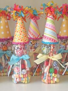 Put the party hats on the favor containers. Makes for a cute presentation.