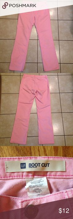 GAP Bootcut Pink Corduroy Jeans Light bubblegum pink cords are perfect for the fall, winter and spring weather! Small, light marking on back of right leg- see photo. Otherwise they are in beautiful shape. Has stretch to the material, so they will look good in all the right places! GAP Pants Boot Cut & Flare