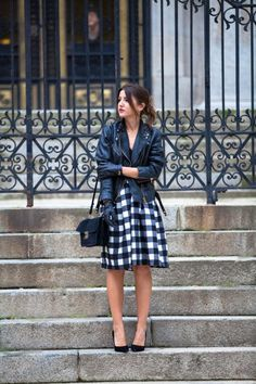 The Midi Skirt and Leather Jacket Combo Is One Youll Want to Try ASAP - moto jacket + leather gloves worn with a preppy black and white plaid midi skirt + pumps
