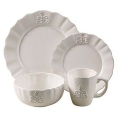 Sixteen-piece earthenware dinnerware set with scrolled detailing.    Product: 4 Dinner plates4 Salad plates4 Bowls4 MugsConstruction Material: EarthenwareColor: White        Dimensions: Dinner Plate: 10.75 Diameter eachSalad Plate: 8.25 Diameter eachBowl: 6.5 Diameter eachMug: 4 Diameter each          Cleaning and Care: Dishwasher safe