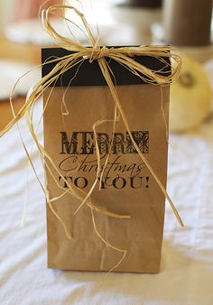 """Personalized Christmas Bags- (Get Dollar Store brown mostly plain bags, using black marker and thick stencils, write on each, """"Santa's Special Gift for"""" and write cursive names."""