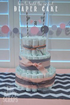 How to make the Perfect Diaper Cake at www.thehappyscraps.com #diapercake #babyshower #thehappyscraps