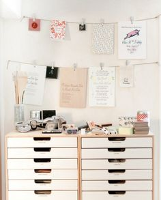 Home office inspiration. I love the line of photos, posters and documents clipped beautifully on a string. And that file cabinet drawers. Time to re-organise!