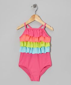 This suit is ready for everything from bounding into waves to hitting up the ice cream truck with its thoughtful, bright details and stretchy silhouette.85% polyester / 15% spandexMachine wash; tumble dryImported