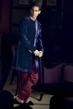 Velvet Indo-western sherwani with patiala embellished with zardosi on collar and buttons.