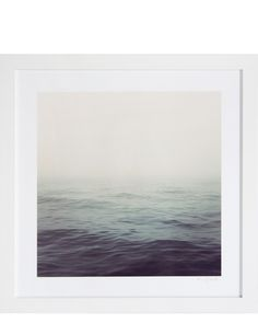 """Archival photographic print in contemporary wood frame. Photograph taken of the Hudson River in New York, New York.  21.5"""" x 21.5""""  Origin: New York, New York  Condition: New.  A native New Yorker, Emily Baker studied Studio Art at Middlebury College and has since built an extensive portfolio of photographs, oil paintings, and watercolor illustrations. Emily is often inspired by beauty found in nature; her work captures the subtle details of natural landscapes—while incorporating elements…"""