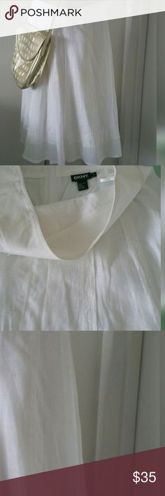 DKNY Linen Skirt A-Line Beautiful  DKNY Linen Skirt A-Line Gorgeous linen skirt from DKNY.  An absolute must for any closet!  Great with sweater or jacket. Fully lined. Zip closure. New condition. Length 24 inches. Waist 30 inches. Skirt goes to the knee. DKNY Skirts A-Line or Full