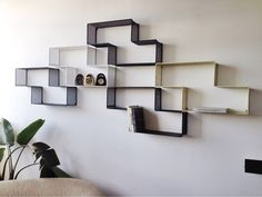 Set of Modular Dedal Shelves by Mathieu Matégot | From a unique collection of antique and modern shelves at https://www.1stdibs.com/furniture/storage-case-pieces/shelves/
