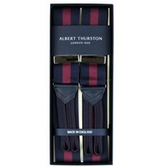 Exquisite Trimmings | Accessories | Braces | Navy and Wine Wide Stripe Barathea Braces. Classic navy braces with a wide wine stripe. Finished with navy leather and navy braided ends. Albert Thurston use a blend of 53% nylon and 47% cotton for their barathea fabric.