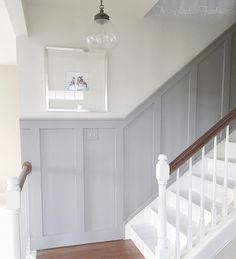 cottage style stairwell - DIY board and batten trim painted SW Functional Gray