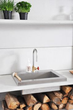 outdoor sink + wood storage
