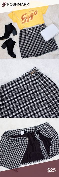 "🦋Wraparound Skirt This is a super cute vintage skirt! Originally a larger size, I had it altered to fit a size 4/6 and be a little shorter for a modern flair. It has an attached lining inside so you won't get any static cling. The clasp is actually a shiny silver color not tarnished at all (hard to capture in pictures) has two buttons on the inside to help the skirt stay closed.  Waist: 26"" Length: 15"" Vintage Skirts Mini"