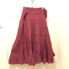 Burgundy Boho Tiered Skirt XL This skirt is in great condition, its only flaw is a missing hook from the top of the side zipper. It's not necessary to wear and the zipper stays in place fine without it. The skirt is cotton, but does not stretch. It fits a size 16-18 best. Uniform by John Paul Richard Skirts Maxi