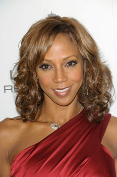 Holly Robinson Peetes layered hairstyle with bangs
