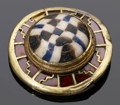 Sword fitting found in a field in 2009 (garnet, millefiori glass and gold cloisonne) 7-8th C, Anglo-Saxon