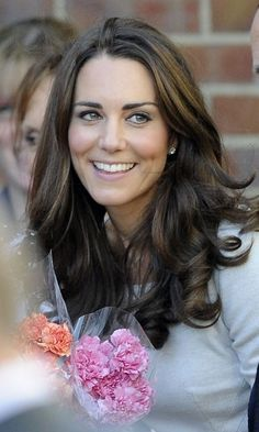 Catherine, Duchess of Cambridge smiles as she leaves after a visit to the Royal Marsden hospital in Sutton, southern England,