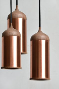 Copper and Wood Pendant Lights by Steven Banken. The walnut top fits neatly onto the copper tubing, which bounces light around for a warming effect.