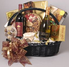 Deluxe Wine Basket: The best of both worlds. Our very popular deluxe wine basket includes, two bottles of fine wine (one red and one white) , one pound of handmade chocolates, one pound of chocolate t (Cheese Chips Packaging) Alcohol Gift Baskets, Valentine's Day Gift Baskets, Themed Gift Baskets, Alcohol Gifts, Raffle Baskets, Wine Baskets, Gift Hampers, Basket Gift, Valentines Day Chocolates
