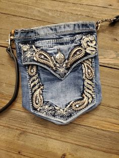 Up cycled Miss Me Jeans-Tush Sac Adjustable leather cross body strap Super cute bag perfect size for a phone, keys and small wallet or put some cash and a card in he front pocket. Fully lined. Jean Pocket Purse, Denim Purse, Miss Me Jeans, My Jeans, Blue Jeans, Childrens Purses, Diy Bags Patterns, Bag Pattern Free, Denim Ideas