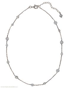 "Gleaming facets of Cubic Zirconia dance with light on this Sterling Silver Necklace. 16"" with a 2"" Extender."