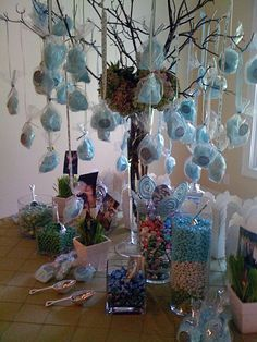 Everyone loves this idea for a party or wedding... candy table anchored by a huge cotton candy tree mixed with rock candy would be cute