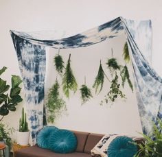This is a great idea for event styling the fabric swag is really simple and easy to execute but makes a big impact.  Tack a few ferns underneath and style up a sweet couch for a killer boho lounge.