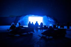 Picture of a group of people watching a movie that is being projected onto an iceberg