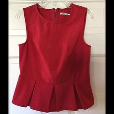 Kimchi Blue red peplum top This stunning red peplum top has a back zip entry. 93% polyester, 7% spandex. Machine wash and dry. Underarm across 14 inches. Length 19 inches. Very good condition. Bundle for even bigger savings! Offers welcome. No trades. Urban Outfitters Tops Blouses