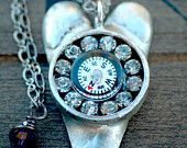 Metalwork heart with compass and rhinestones. Custom closure with Swarovski crystal.  Handcrafted bezel.