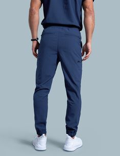 Jogger Pant in Estate Navy Blue is a contemporary addition to men's medical scrub outfits. Shop Jaanuu for scrubs, lab coats and other medical apparel. Jogger Pants, Joggers, Dental Uniforms, Stylish Scrubs, Cute Scrubs, Scrubs Outfit, Medical Scrubs, Insta Photo Ideas, Scrub Pants