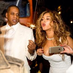 Beyonce and Jay-Z light sparklers and don all-white looks at Solange's NOLA wedding // Photo via Instagram.com/UsWeekly