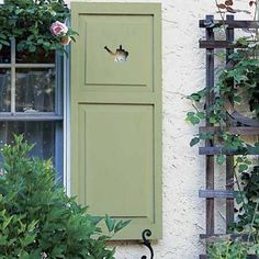 Nice custom cutout of a watering can in these cottage shutters. Cottage Shutters, House Shutters, Garden Structures, Outdoor Structures, Cedar Trellis, Shutter Dogs, Japanese Painted Fern, Garden Features, Garden Photos