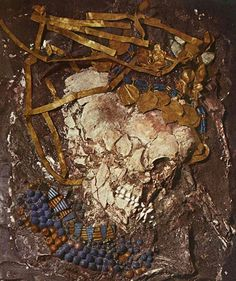 The flattened skull and jewelry of Queen Puabi just as it was found in her tomb at Ur in Sumeria