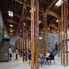 Clustered lengths of bamboo create a forest of columns in the open-air dining room of this Vietnam restaurant by Vo Trong Nghia Architects.