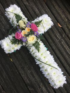 When you need a funeral arrangement that shares your sincere emotions, love and appreciation to a special someone in your life, this beautiful cross-shaped tribute is a very appropriate choice. Funeral Floral Arrangements, Easter Flower Arrangements, Sunflower Arrangements, Creative Flower Arrangements, Easter Flowers, Rose Arrangements, Beautiful Flower Arrangements, Grave Flowers, Cemetery Flowers