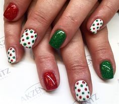 Brighten up your nails this Christmas with this simple design - green and red glitter nail polish with dots on the white nails - simple but effective