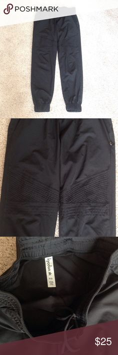 """Kyodan long black pants Never worn. Has 2 pockets. Inseam is 30"""" long. Model is wearing a similar style.                           d Kyodan Pants"""