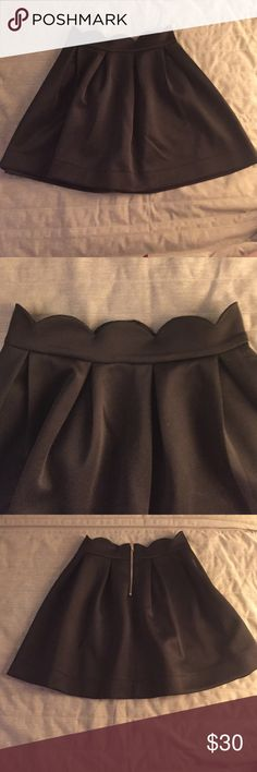 Black scalloped skirt From francesca's Great material, will last forever. Cute scallop design at the top. Love this skirt it's just a little too long on me!! But in perfect condition and perfect for the holidays! Looks cute with a crop top or tucked in top. Can even be worn to work. Zipper in back. Size medium and runs true to size! Francesca's Collections Skirts A-Line or Full