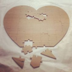 Personalised wood heart wedding jigsaw guest puzzle. Guests can write their message or sign their name and the centre piece has the bride and grooms name and wedding date stamped onto it