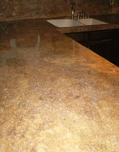 Stained concrete counter tops like this color would look great with light or dark colored cabinets