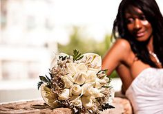 Bridal bouquet showing off Calla Lilies, freesias, and white roses are this Bride's fragrant choice - just stunning!!! MTM Photography in Mayan Riviera Wedding Photographer. Wedding Photographer photos in Cancun, Playa del Carmen, Puerto Morelos, Puerto Aventuras and Tulum. www.MomentsThatMatterPhotography.com