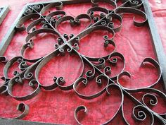 A couple years back I came across this post on making wrought iron like wall art out of the cardboard tubes inside toilet paper and paper...